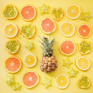 An array of fruit with a yellow background
